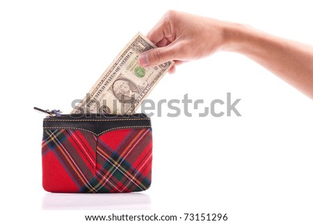 Hand Putting Dollar Bill Into Coin Wallet