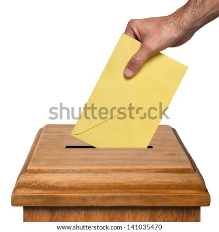 Hand putting envelope into the box isolated on white background, clipping path. - stock photo