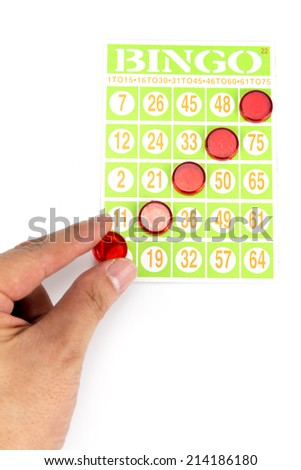 hand putting last chip to be winner of bingo game isolated on white background - stock photo