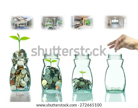 Hand putting mix coins and seed in clear bottle with step of construction house ,Business investment growth concept - stock photo