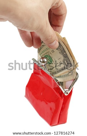 Hand putting money into red purse  isolated on white - stock photo