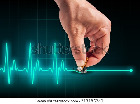 Hand putting out cigarette on heart beat line turquoise background - Anti smoking concept - Health hazard - stock photo