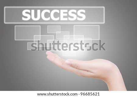 Hand putting Success word button.