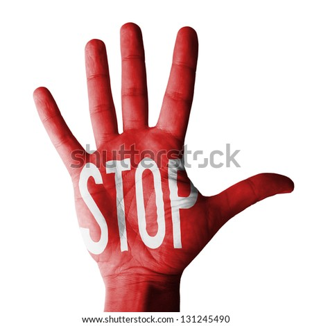 Hand raised gesture with stop sign painted, multi conceptual purposes- isolated on white background - stock photo
