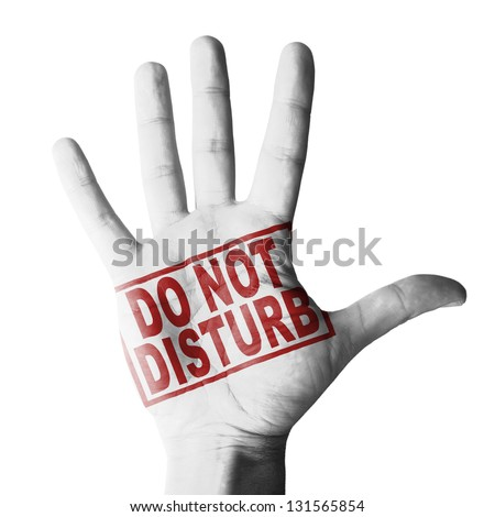 Hand raised with Do Not disturb tag painted - isolated on white background - stock photo