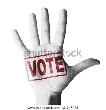 Hand raised with VOTE tag painted - isolated on white background - stock photo