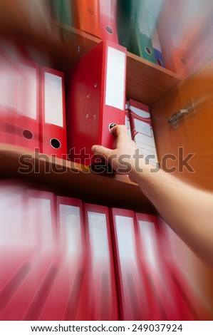 hand reaching for the briefcase of documents - zoom in - stock photo