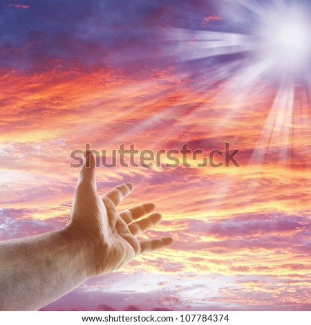Hand reaching for the sky - stock photo