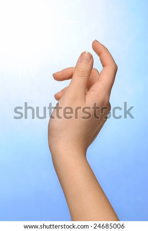 Hand reaching out into the sky - stock photo