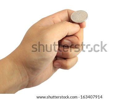 Hand ready to flip coin - stock photo