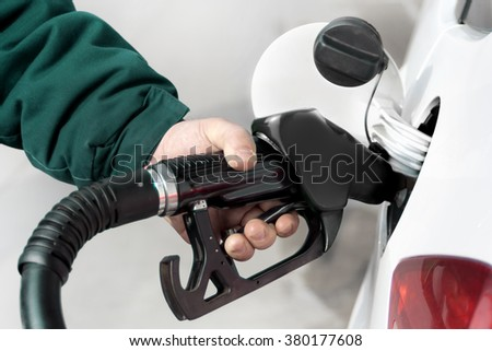 Hand refilling the car with fuel. Diesel