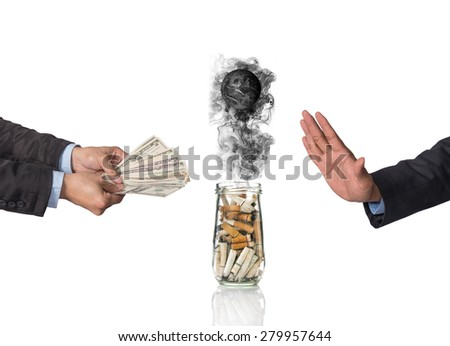 Hand refusing the money offered with Cigarette butt in bottle with smoke Burning the world, world no tobacco day, Elements of this image furnished by NASA - stock photo