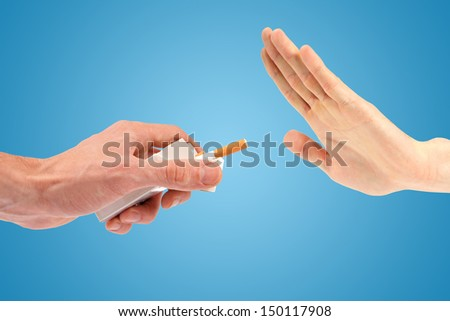 hand reject a cigarette offer. isolated on blue - stock photo