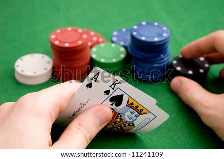 Hand revealing AK - stock photo