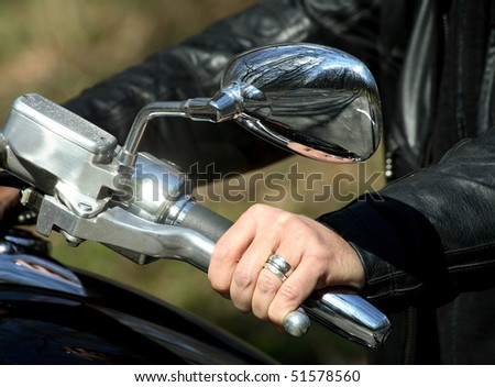 Hand rider on the handlebars - stock photo