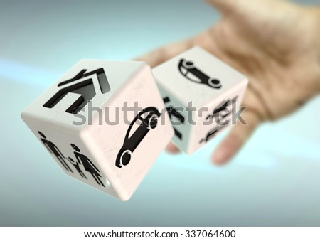 Hand rolling 2 dice with home, family and car symbols. Concept for risking everything you own and taking a chance. Despair, desperation