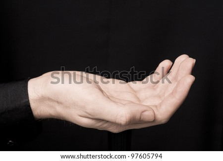 Hand's of man that holding something invisible. Copy space