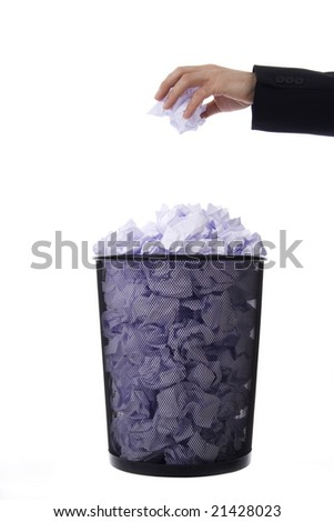 Hand scrapping paper to the baskets,on white background. - stock photo