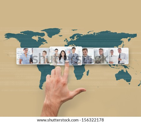 Hand selecting futuristic interface showing business people - stock photo