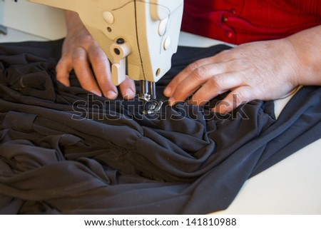 Hand sewing on a machine; woman cooks