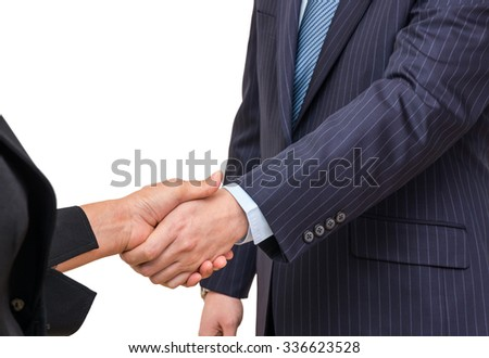 Hand shake between a businessman and a businesswoman on white background - stock photo