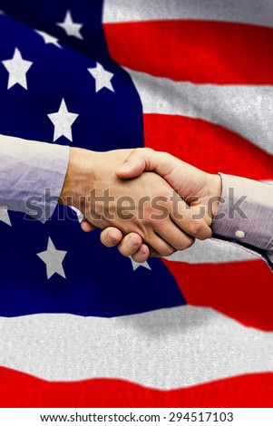 Hand shake in front of wires against black wall