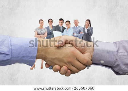 Hand shake in front of wires against white background - stock photo