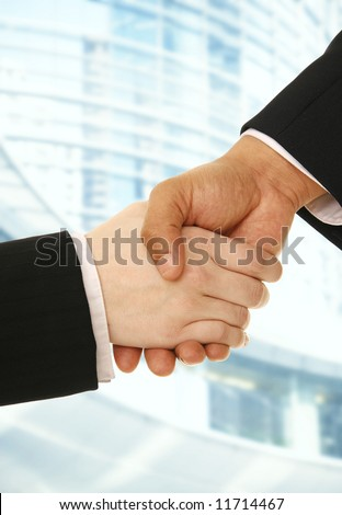 hand shake of business man and woman making a deal with contemporary abstract on the background