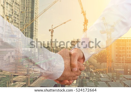 hand shake over construction site