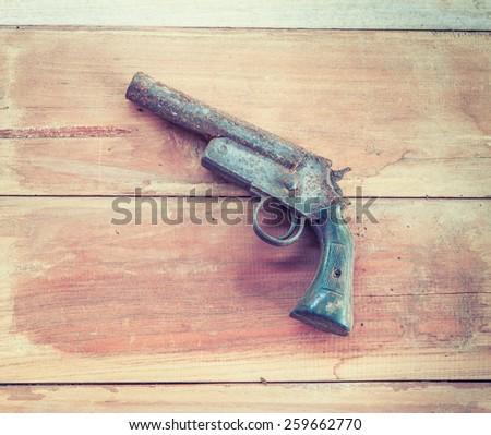 hand shot gun on the wooden board,old shot gun of Thailand, Vintage style  - stock photo