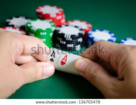 Hand show pair of aces chance of winning - stock photo
