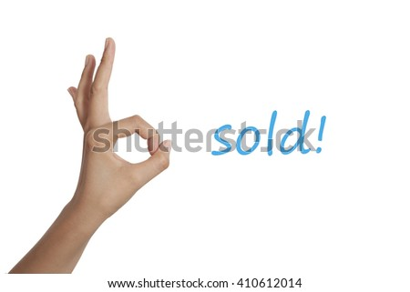 hand show sold word on white background for business creative idea