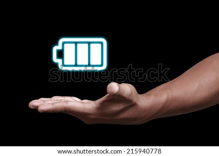 Hand showing a battery icon - stock photo