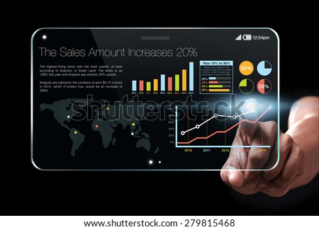 Hand showing a transparent tablet with colorful business information on screen, representing business growth. Chart is colorful and the background is black.