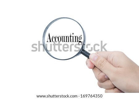 Hand Showing Accounting Word Through Magnifying Glass - stock photo