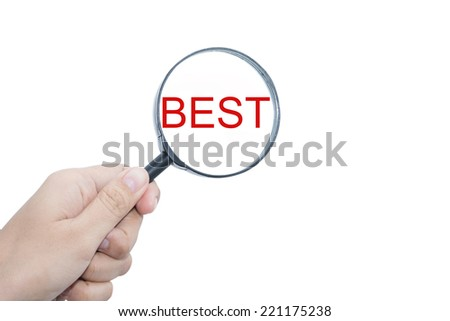 Hand Showing BEST Word Through Magnifying Glass
