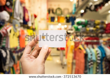 Hand Showing Blank Credit Card With Eletronic Chip In The Store - stock photo