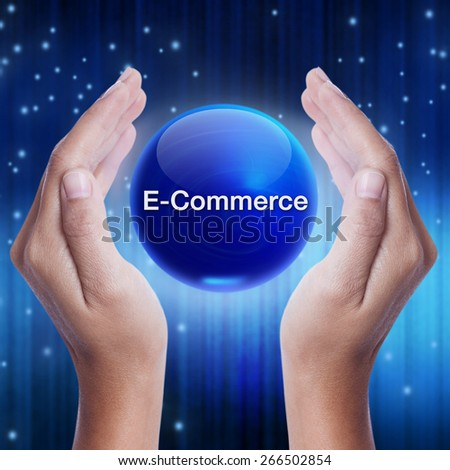 Hand showing blue crystal ball with e-commerce word. business concept - stock photo