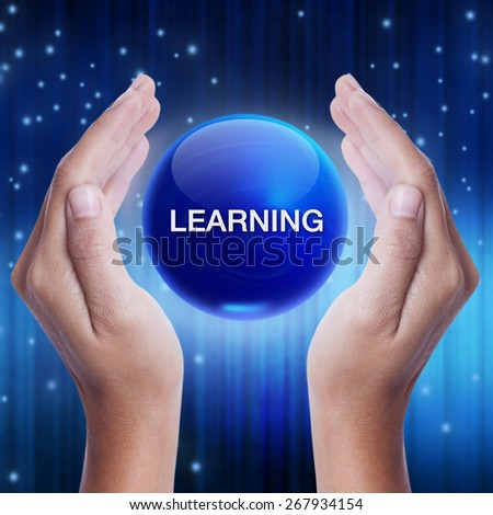 Hand showing blue crystal ball with learning word. business concept - stock photo