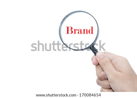 Hand Showing Brand Word Through Magnifying Glass Brand - stock photo
