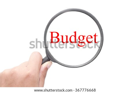 Hand showing Budget word through magnifying glass. Magnifying glass search concept. Isolated on white background. - stock photo