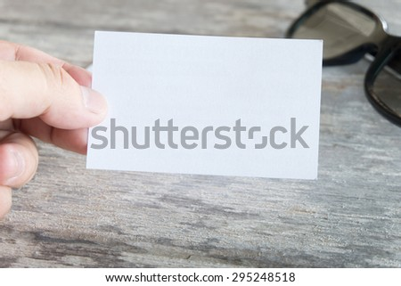 Hand showing business card - stock photo