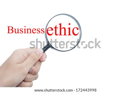 Hand Showing Business ethic Word Through Magnifying Glass   - stock photo