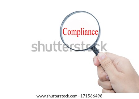 Hand Showing  Compliance Word Through Magnifying Glass - stock photo