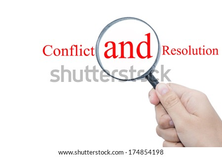 Hand Showing Conflict and resolution Word Through Magnifying Glass