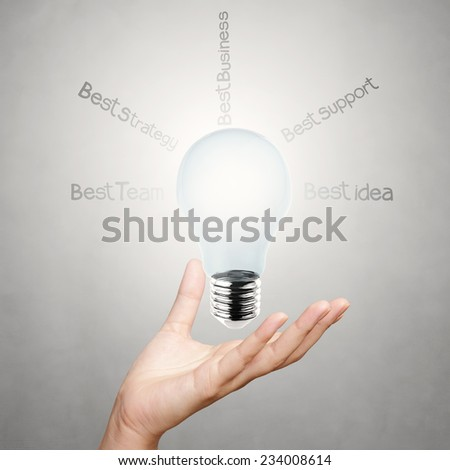 hand showing creative business strategy with light bulb as concept - stock photo