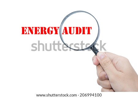 Hand Showing  ENERGY AUDIT  Magnifying Glass  - stock photo