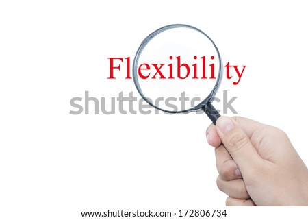 Hand Showing Flexibility Word Through Magnifying Glass   - stock photo