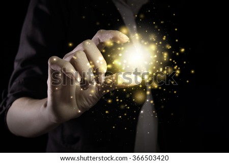 Hand showing gold color magic stars light