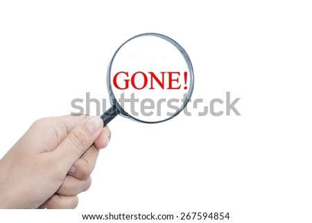 Hand Showing GONE! Word Through Magnifying Glass  - stock photo